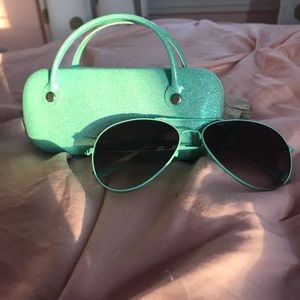 Teal sunglasses with a matching teal case